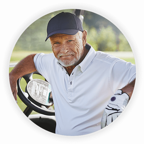 Older man playing golf after cataract surgery