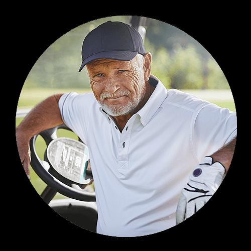Older man playing golf after cataract surgery